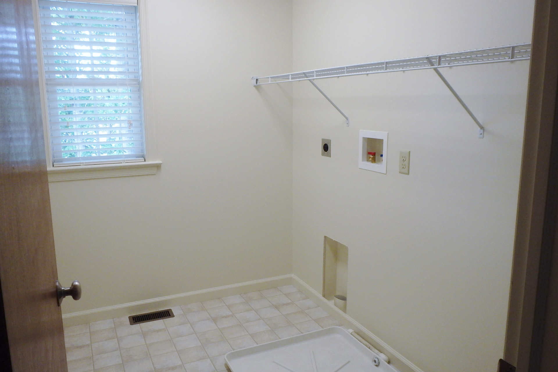 Laundry room photo at 164 McKivision Court in State College PA.