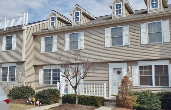 Front photo of the 3-bedroom townhouse for rent at 136 Birchtree Court in State College, PA.