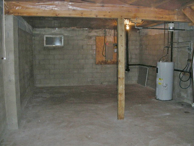 Unfinished basement at 724 Southgate Drive.