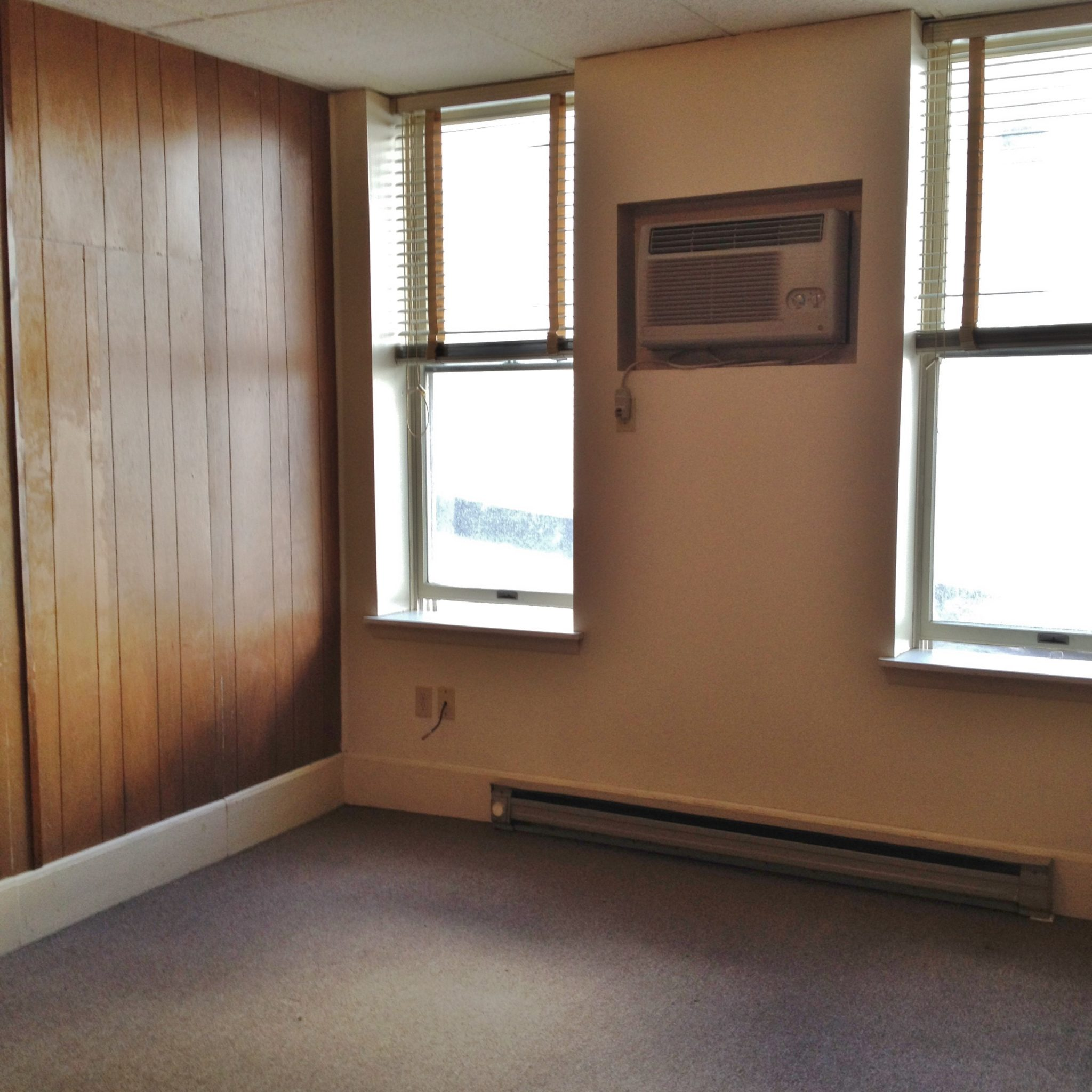 Photo of the living room in Apt. #2, 212 W. High Street.
