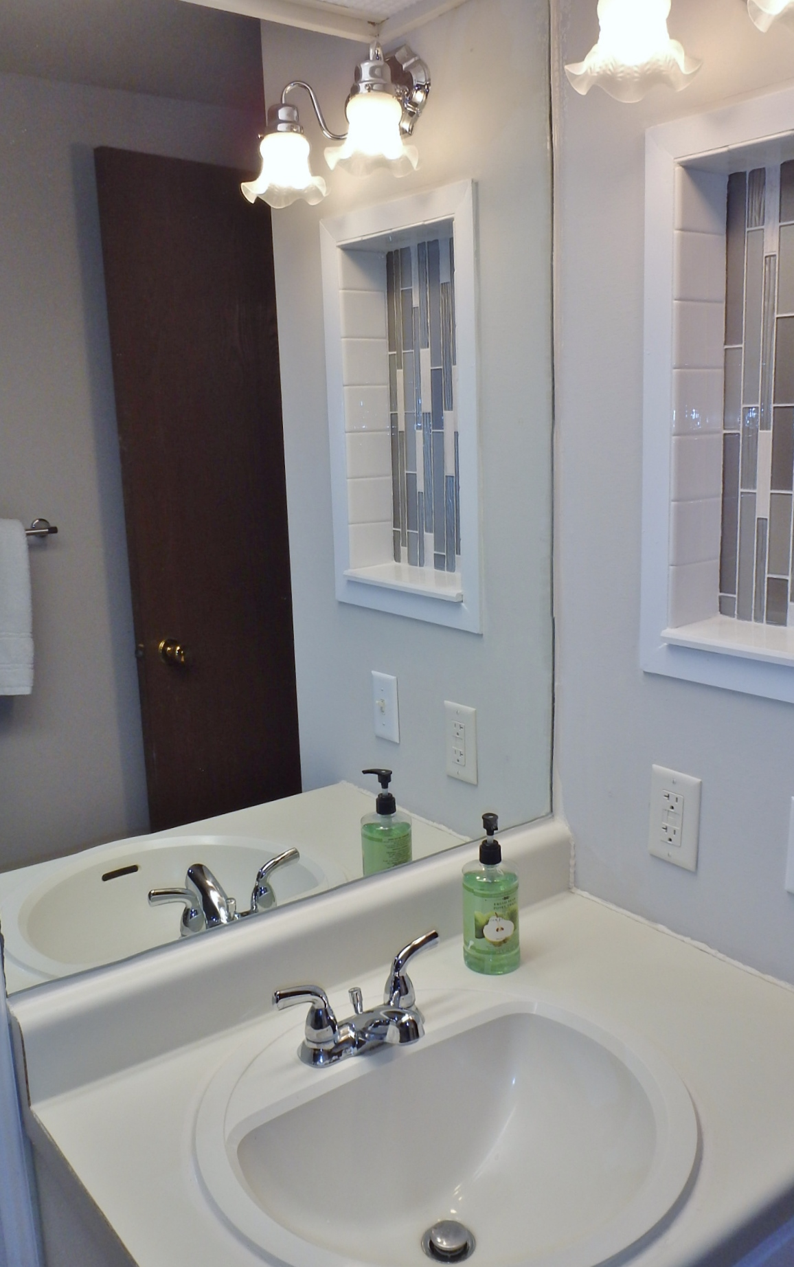Bathroom vanity photo at 1606 Blue Course Drive.