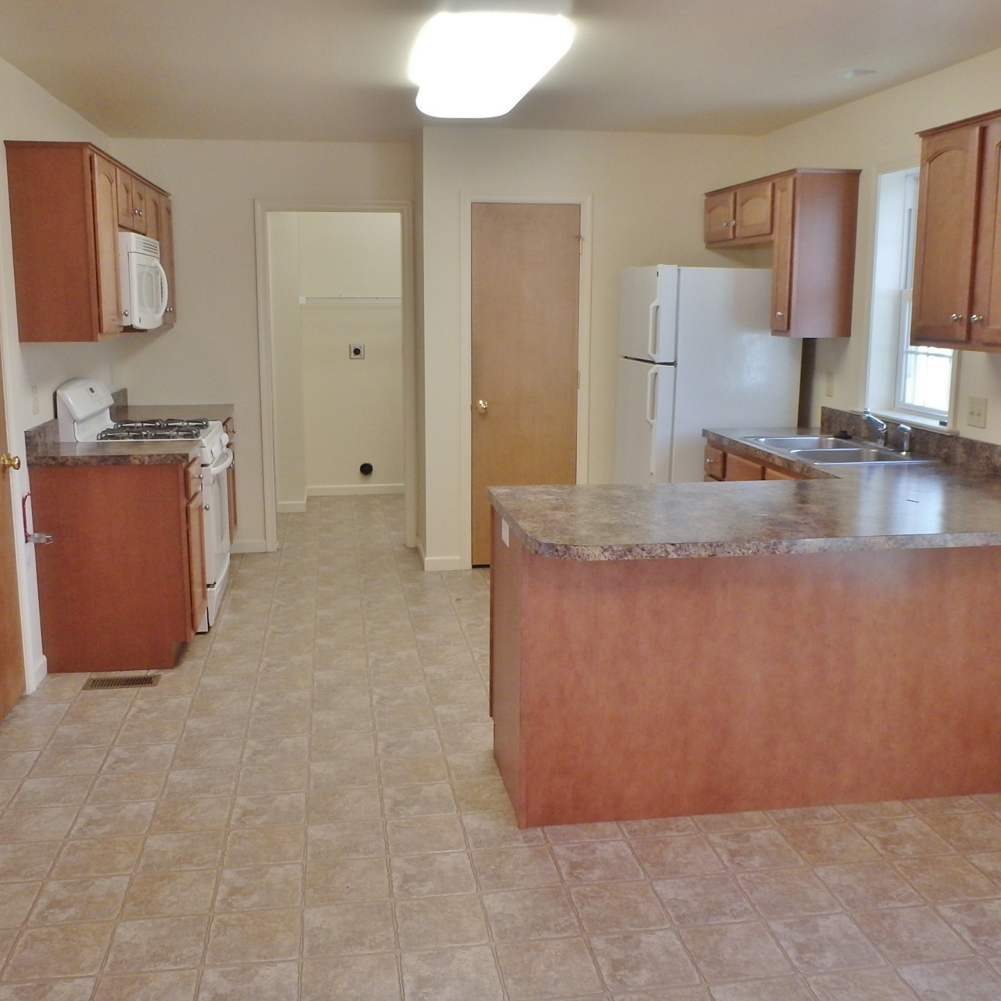 Kitchen photo of the 3-bedroom house for rent at 112 McKivison Court.